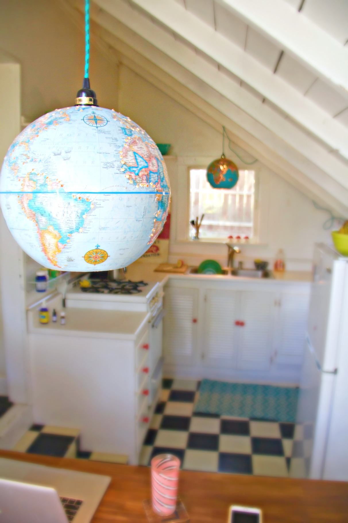 two globes in kitchen