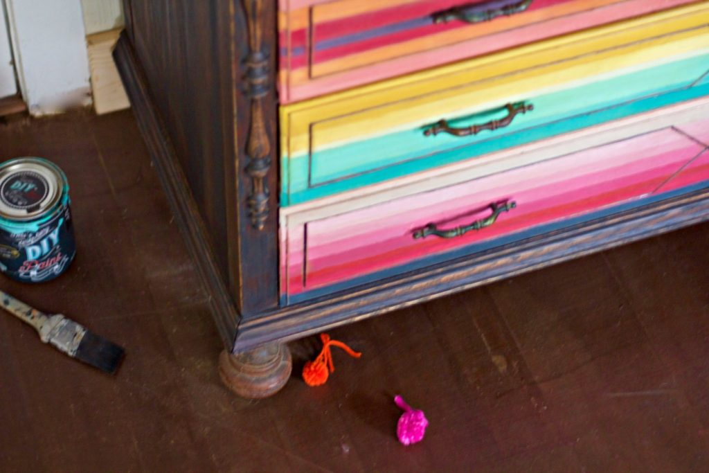mex-dresser-with-poms-on-floor